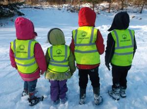 some young volunteers in the snow