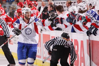 Norway celebrates a goal during its 5-4 victory. Photo: Jukka Rautio / HHOF-IIHF Images