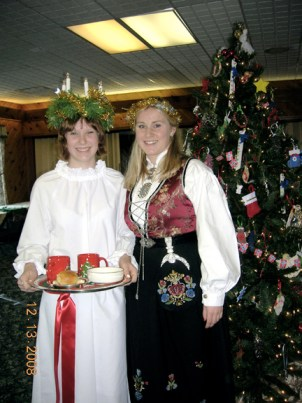 Heritage member Devyn Reilly Packard plays St. Lucia at Maine   Nordmenn's Julefest.  Her attendant, Anne Cecilie Muri, an AFS student from Nesøya, Norway, is an honorary member of the lodge. Photo: Eleanor Froiland Andrews