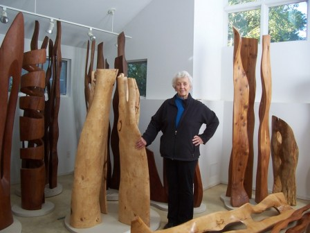 Artist Constance Bergfors stands among maple, cherry, and walnut sculptures in her home studio, near Washington, D.C.  A few of her works are also on display at Tysons Atriums, 1650 and 1750 Tysons Blvd., McLean, Virginia, until April 8, 2011. See more at www.constancebergfors.com