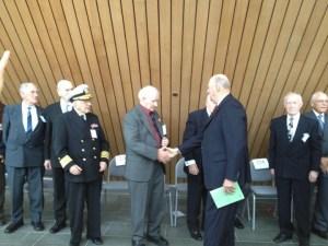 Olav Vedvik shakes the hand of HM King Harald. Photo courtesy Lori Vedvik.