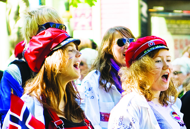 Photo: Ivar Husevåg Døskeland / Wikimedia Commons  Girls singing during the children's parade in Trondheim on the Norwegian national day, 17 May.