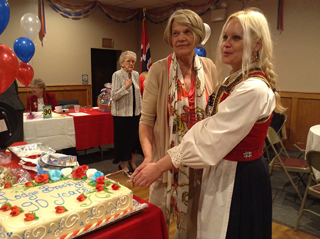 Photo: Ester Hall Brooklyn Lodge's president of 12 years, Sigrun DiRienzi, and incoming president Corinne Hall cut the birthday cake.