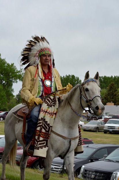 "Photo: Robert Leitner Chairman Tex Hall of the MHA Nation leads the ""Homecoming"" parade to the Knife River homeland."