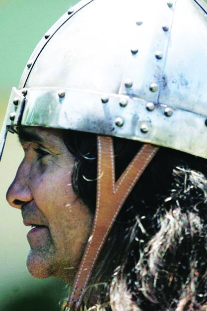 Photo: Judith Gabriel Vinje Jaan Calderon, director of Ravens of Odin reenactment group, with his sleek metal helmet. In Viking days, such a helmet would have cost the equivalent of about $6,000.