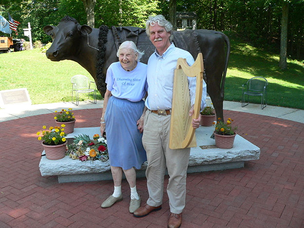 Photo: courtesy of Philip Boulding Boulding and son Philip pose with the bronze statue Emily the Sacred Cow at the Peace Abbey. Emily became a famous cow when she escaped from a slaughterhouse in 1995, and she was buried behind her statue in 2003 after dying from cancer. Hair clippings were also released into the Ganges as part of a sacred cow ritual.