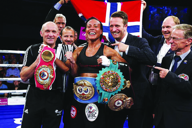 """Photos: """"The First Lady"""" Cecilia Brækhus / Facebook After making history she's all smiles."""