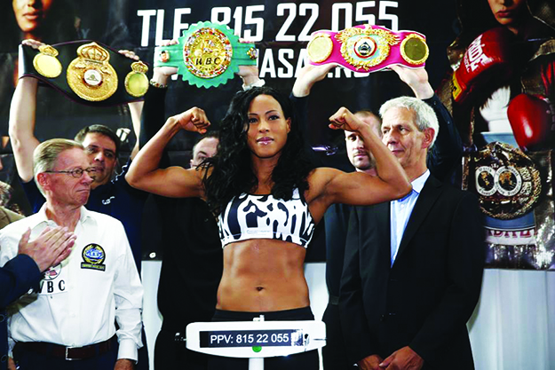 """Photos: """"The First Lady"""" Cecilia Brækhus / Facebook Brækhus shows off her guns at the weigh-in before the fight."""