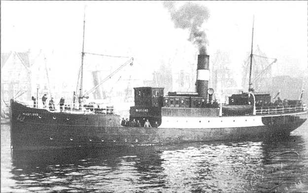 """Photo courtesy of Jon Lind The steamer """"Masfjord"""", built in 1908, that sank that fateful morning in 1918 at Solesjøen.  She was refloated but sank again (for the final time) in 1944, ironically, in the fjord whose name she carried."""