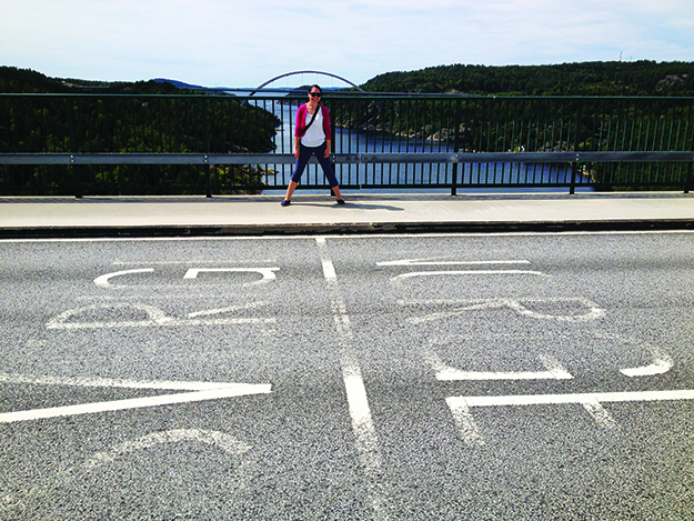Photo: Molly Jones Molly stands in both Norway and Sweden, atop the old Svinesund Bridge.