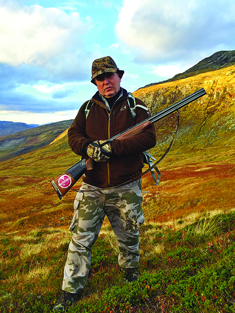 Photo: Nils Wanberg Erik with his shotgun.