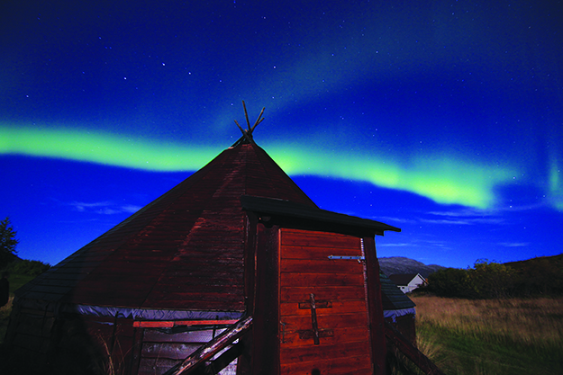 Photos: Tromsø Friluftsenter The northern lights provide a lively backdrop for all of Northern Norway's scenery, from fjords and cities to gentle hills and traditional Sami huts.