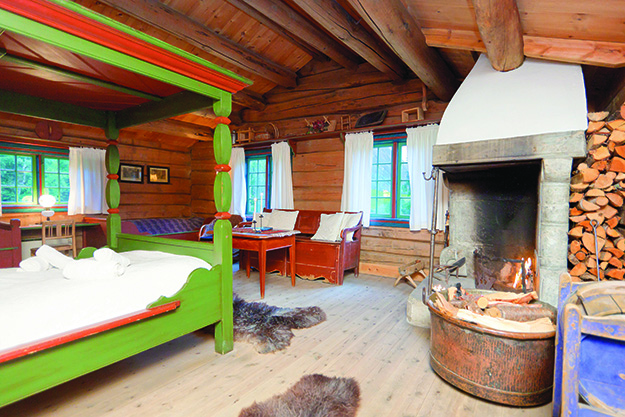 Photo: Espen Mills / Visitnorway.com One of the rustic yet comfortable rooms at the Røisheim Hotell, where Norway's peaks, lakes, and glaciers await.