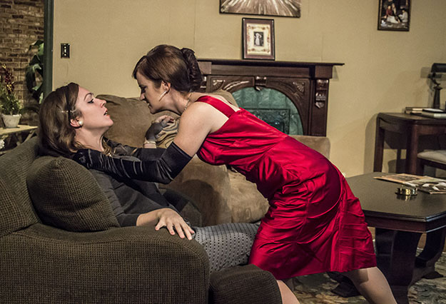Photo: St. John Blondell Sarah Ferris as Thea is menaced by Katie Culligan as Hedda.