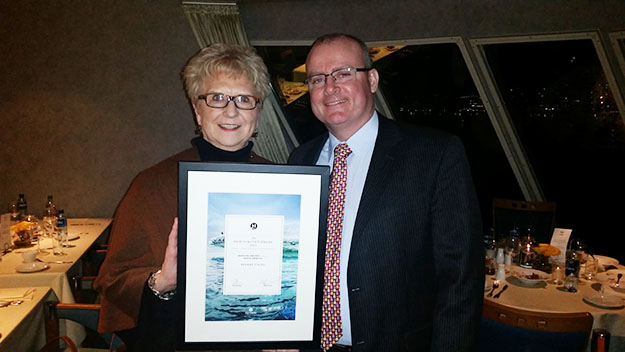 Photo courtesy of Brekke Tours Char with Hurtigruten General Manager Gordon Dirker at the awards ceremony.