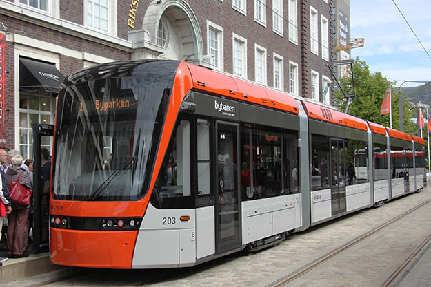 Photo: Nina-no / Wikimedia Commons  Bergen's light rail train at the terminus between the train station and Byparken, the large park in the city's center. The other terminus on this line is Flesland Airport.