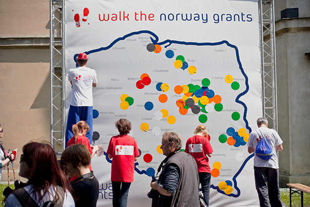 """Photo: EEAgrants.org  Close to 250 people turned out in the old town square in Warsaw in May 2011 to """"Walk the Grants."""" The Norwegian Embassy in Warsaw invited representatives from all funded projects to participate in the Nordic walking event, celebrating the achievements of the more than 400 projects and funds implemented in Poland to date."""