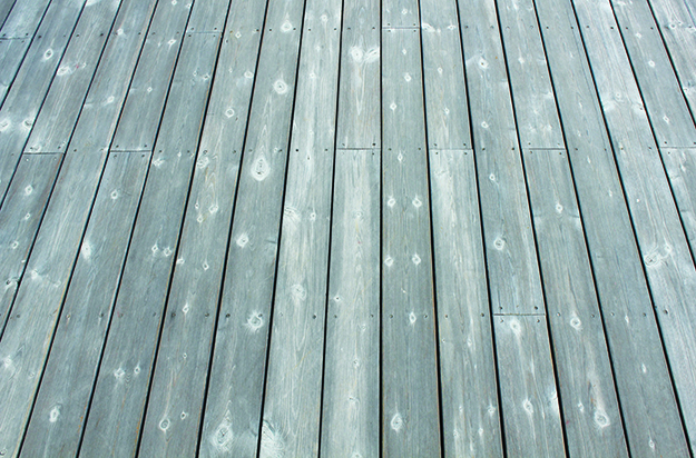 Photo: Øyvind Holmstad / Wikimedia Commons A well-weathered deck made of Kebony wood.
