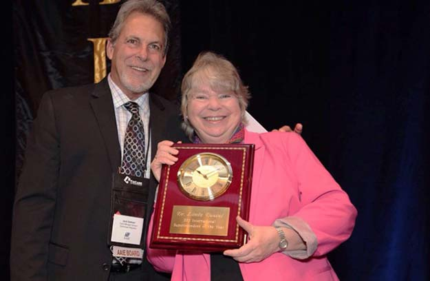 Photo courtesy of the International School Stavanger Linda Duevel is honored as International Superintendent of the Year.
