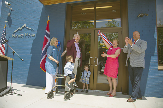 Photo: Mara LeBlanc  The Education Building of Norway House was dedicated on June 14. Here former board Chair Karen Tuzcu, former Consul General for Norway in the Midwest Thor Johansen and his grandsons, former board Chair Linda Brekke Mona, and current board Chair Jon Pederson assist in the ribbon cutting.
