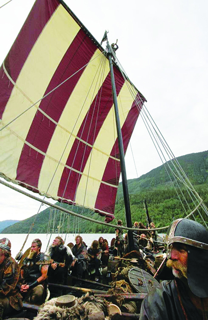 Photo courtesy of Olavs Menn Olavs Menn during filming of a commercial last summer on Lake Bandak. Øystein is in front with the helmet on, and at the top of the mast is Per Øyvind Gulliksen.
