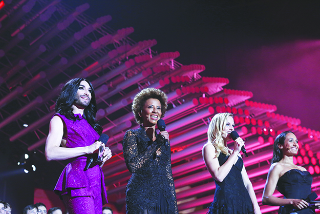Photo: Eurovision / EBU / Thomas Hanses Conchita Wurst (left) and three other contest hostesses.