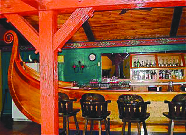 Photo courtesy of Mary Andersen The crown jewel of Land of the Vikings is the impressive Viking Ship Bar, crafted by Bjarne Livolden based on the famous Oseberg viking ship in Oslo.