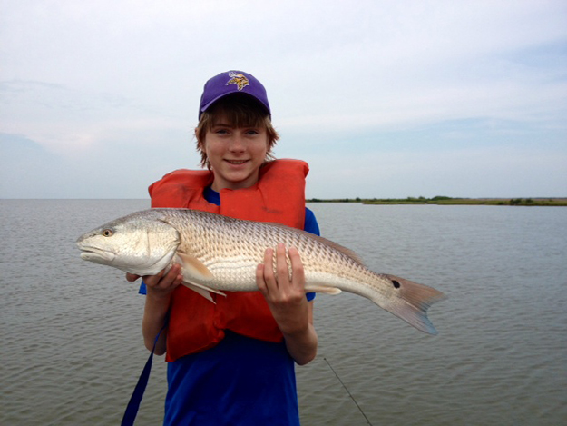 Photo: Sandra Nelson Sandra's grandson, Timo, enjoys fishing in the Gulf south of New Orleans and caught this fish—just one of his many summer activities!