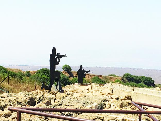 Photo: Emily C. Skaftun Silhouette soldiers point their guns toward Syria.