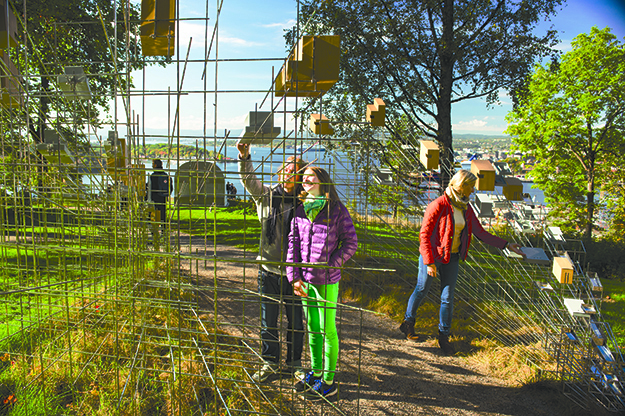 "Photo: CH / Visitnorway.com Sarah Sze's ""Still life with landscape"" mingles an industrial-looking birdhouse complex with a natural backdrop including trees and a killer view of Oslo."