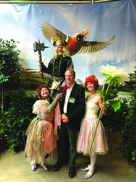 Photo: Emily C. Skaftun Author Eric Dregni poses with Thor and a pair of fairies at Norsk Høstfest.