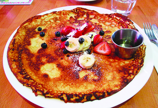 A Norwegian Pancake topped with fresh berries and lavender syrup at Domku cafe
