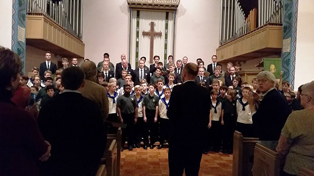 "Photo: Michael Kleiner Sølvguttene Music Director Fredrik Otterstad leads Keystone Boychoir (in dark shirts) and Sølvguttene (white) in singing ""Hallelujah."""