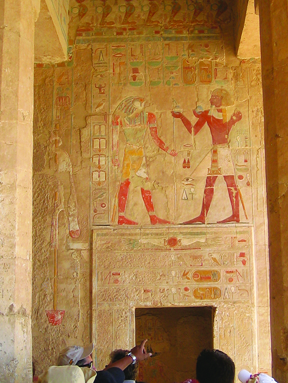 Photo: Arlene & Thor A. Larsen Detailed, colorful sculpture on the wall of Queen Hetshepsut's temple.