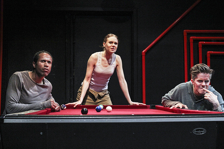 Photo: Kait Ebinger, courtesy of SATC  Then Silence begins with a game of pool but quickly becomes much more—an exploration of humanity and its struggles with power, domination, loss, mortality, and ultimately survival. From left: Kwase Osei as One, Christiane Julie Seidel as Brother, and Morten Holst as Another.