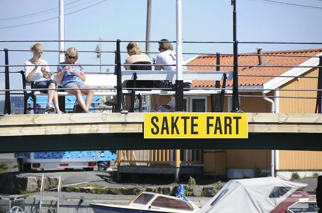 Photo courtesy of Kragerø Blad Sign on footbridge over waterway, indicating what exactly?