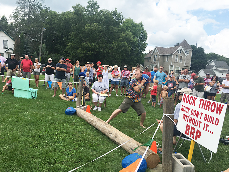 Photo: Emily C. Skaftun,  A contestant winds up for the Rock Throw, one of many sporting events at Decorah's Nordic Fest and one of the three events making up the Ultimate Norseman Competition.