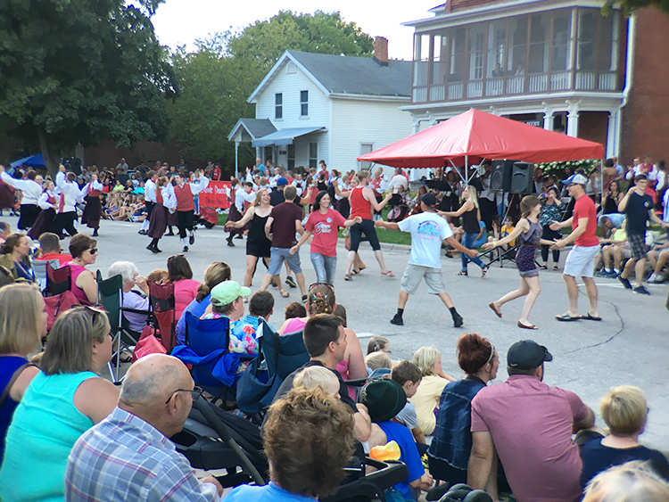 Photo: Emily C. Skaftun The current Nordic Dancers shared the street with alumni of various ages, who all seemed to be having the time of their lives despite not remembering all of the steps. It's a testament to what these dancers mean to the town that there was scarcely room to watch despite chilly weather.