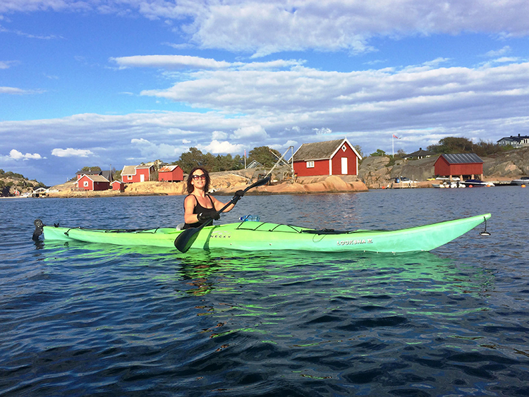 """Photo courtesy of Hilde Janne Skorpen Skorpen in her kayak. """"There is nothing quite as enchanting as feeling one with the water as the kayak glides quietly past reefs and islets on an early July morning."""""""