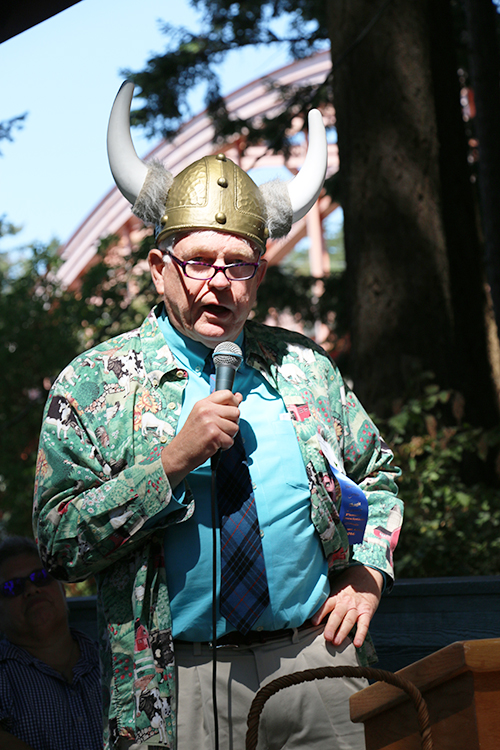 Photo: Solveig Lee Don Wick, winner of the Pioneer Spirit Award, addresses the attendees in his Viking hat.
