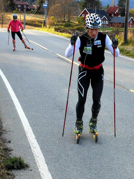 Photo: John Erik Stacy A somewhat irked-looking Marit Bjørgen rollerskis past John Erik in the summer of 2011.