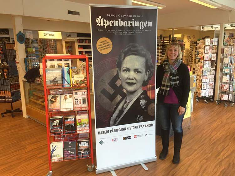 Photo: Florian Haberland A cast member poses with a poster advertising their performance.