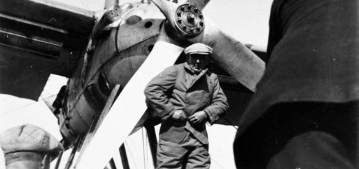 Amundsen standing in front of an engine.