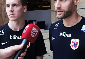 Two soccer players being interviewed.