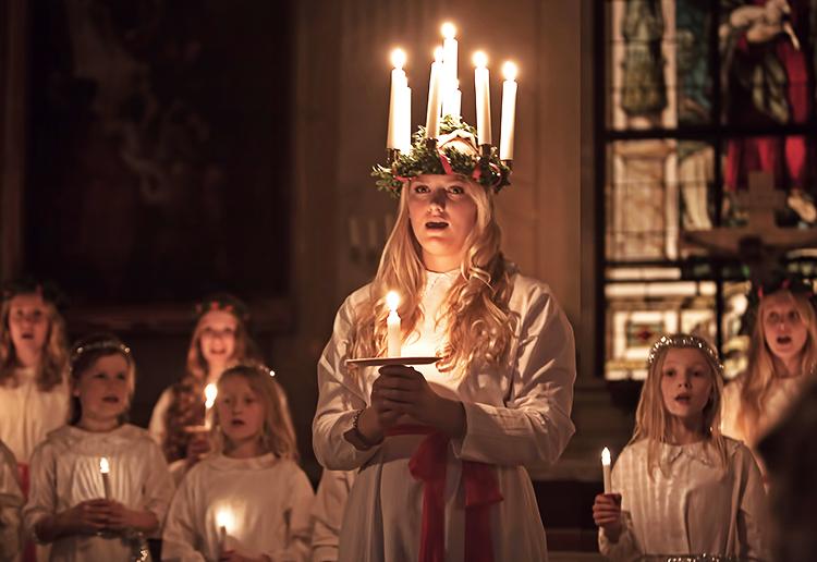 A girl dressed as Sankta Lucia.