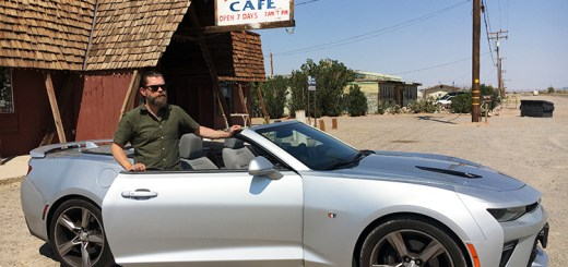 Ørn next to the car in front of the Bagdad Cafe.