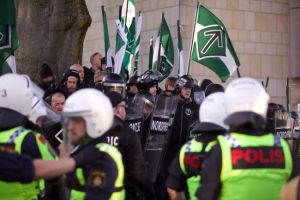 Norwegian neo-Nazis display their flag at a rally.