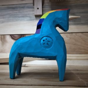 A carved Dala horse-style unicorn