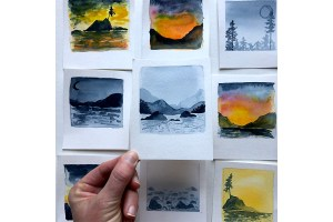 Small cards with watercolor painted lancscapes made to look like polaroid pictures