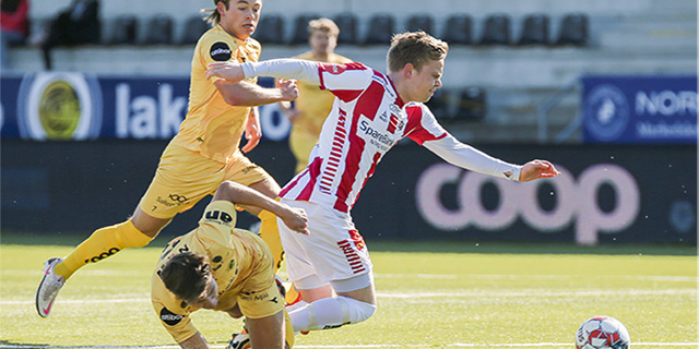 bodø/glimt and tromsø teams fighting for the soccer ball